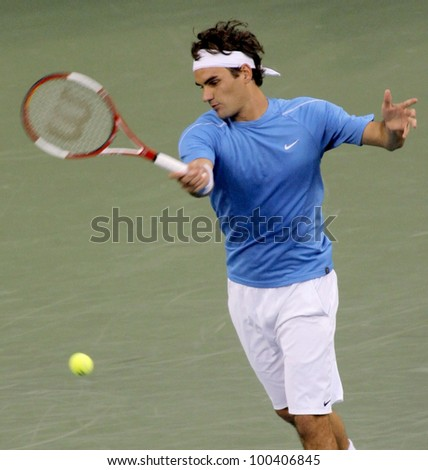 FLUSHING, NY - SEPTEMBER 10: Roger Federer serves to Andy Roddick during the US Open at the USTA National Tennis Center on September 10, 2006 in Flushing, NY. - stock photo