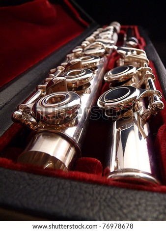 flute A concert flute is lying in a carrying case - stock photo