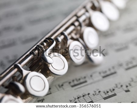 flute and music sheet with XIX century Puccini Aria - stock photo