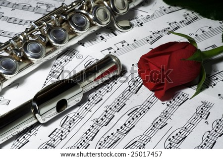 Flute and rose - stock photo