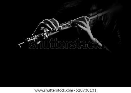 Flute instrument closeup Flutist hands playing flute music isolated on black background