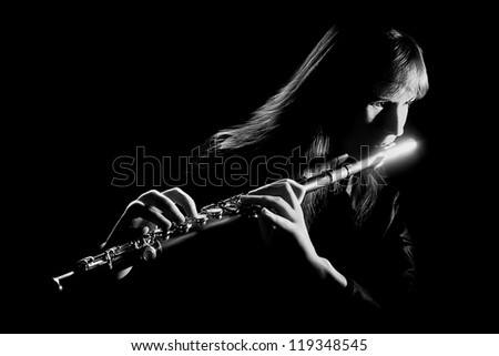 Flute music instrument flutist musician classical playing isolated on black. Focus is on the hands with flute - stock photo