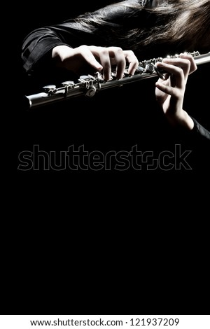 Flute music playing flutist musician performer with bright musical instrument - stock photo