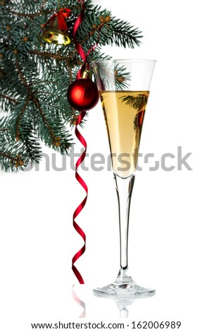 Flute of champagne in holiday setting. Closeup. - stock photo