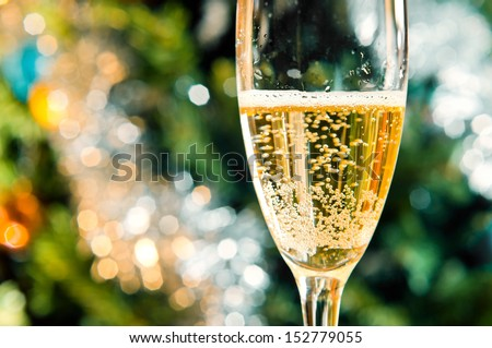 Flute of champagne in holiday setting, focus on a foreground - stock photo