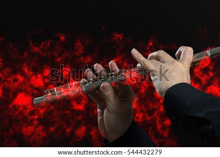 flute on black with red fire