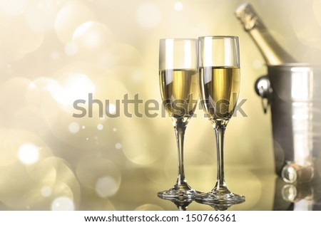 Flutes of champagne in holiday setting - stock photo