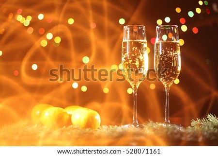 Flutes of champagne in holiday setting.