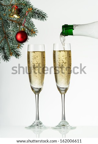 Flutes of champagne in holiday setting. Closeup. - stock photo