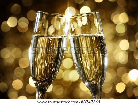 Flutes of champagne in holiday setting,Closeup. - stock photo