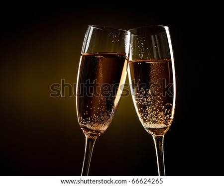 flutes of champagne over yellow background - stock photo