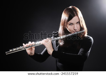 Flutist playing flute music instrument player classical musician