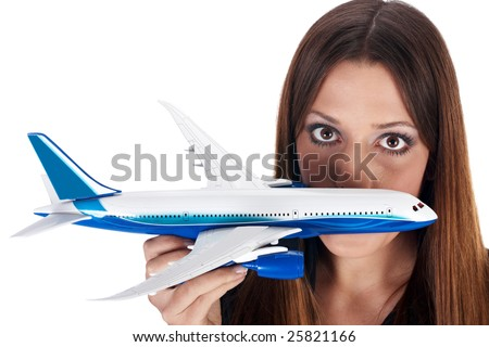 Fly fear metaphor by woman holding airplane in hand. - stock photo