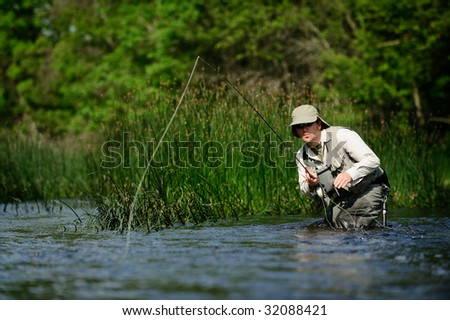 Fly-fisherman casting - stock photo