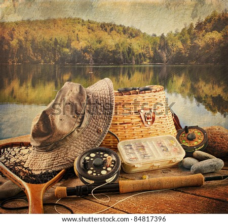 Fly fishing equipment on deck with a vintage look - stock photo