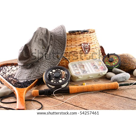 Fly fishing equipment on white background - stock photo