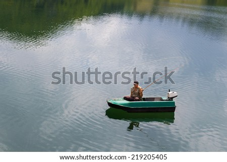 Fly fishing from the boat - stock photo