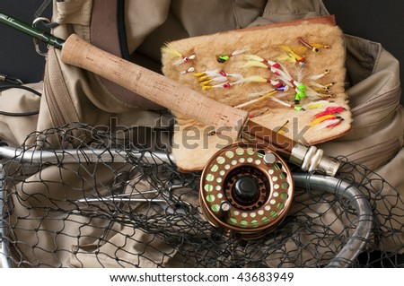 Fly fishing gear in anticipation of a future catch - stock photo