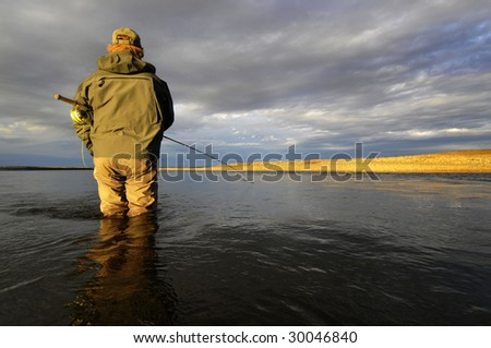 Fly fishing in Argentina - stock photo