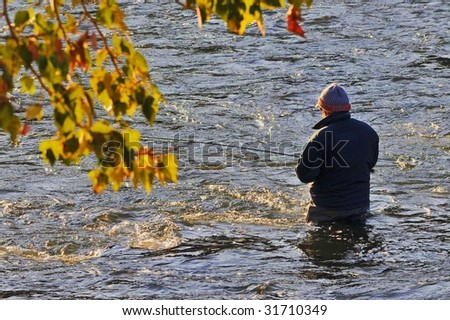 Fly fishing in autumn - stock photo