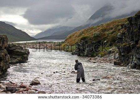 Fly fishing in Greenland - stock photo