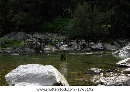 Fly fishing in Montana - stock photo