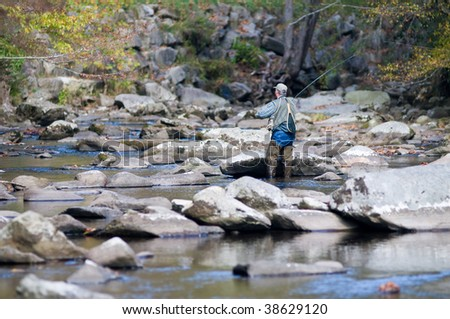 Fly fishing in the Little River of the Great Smoky Mountains National Park - stock photo