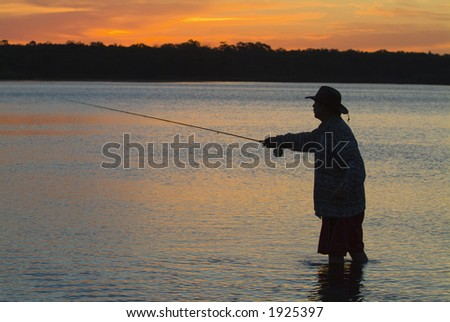 Fly fishing in the morning sun 02 - stock photo