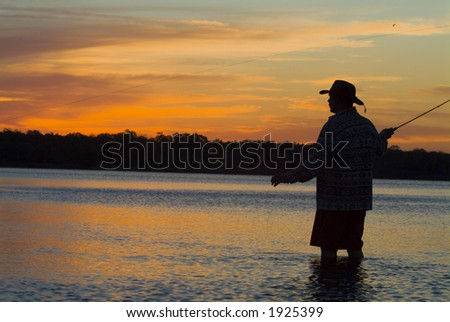 Fly fishing in the morning sun 04 - stock photo