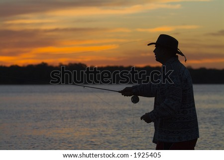 Fly fishing in the morning sun 10 - stock photo