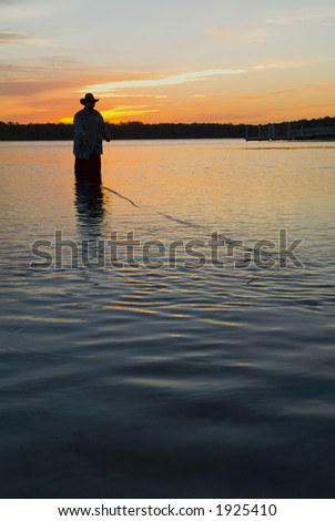 Fly fishing in the morning sun 15 - stock photo
