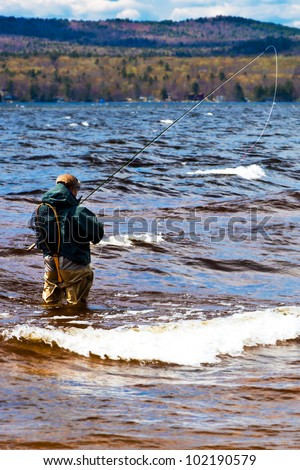 Fly fishing.  Location is a lake in Maine - stock photo
