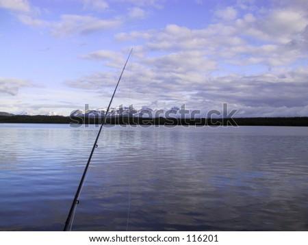 Fly Fishing on Kelly Lake, Alaska - stock photo