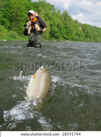 Fly fishing on river - stock photo