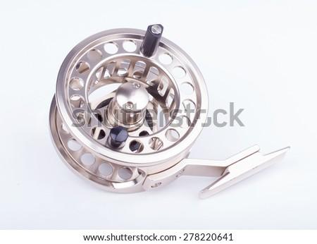 fly fishing reel on white background - stock photo