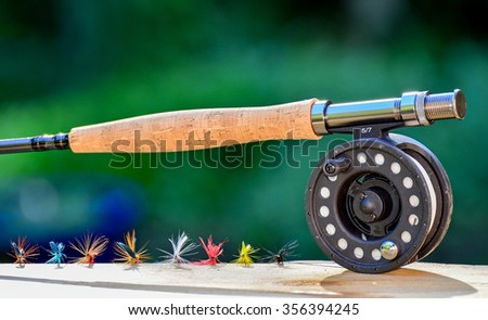 Fly fishing rod and flies - stock photo