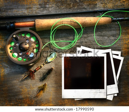 Fly fishing rod with instant photo pictures on wood background - stock photo