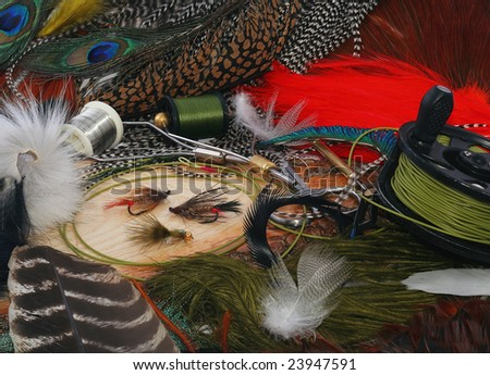 fly-fishing &  tying fly in Wooden - stock photo