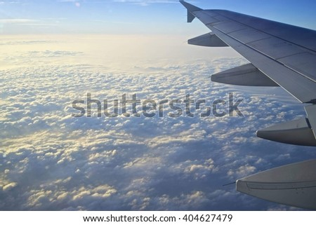 Fly high in cloudy sky - stock photo