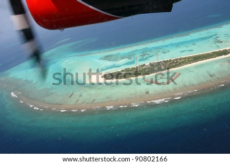 fly in a seaplane over the Maldives