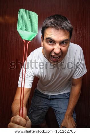 fly killing man - stock photo