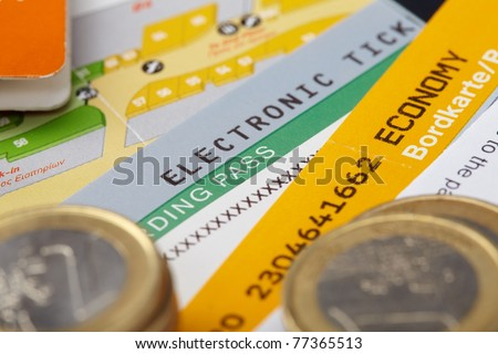 fly tickets and money - stock photo