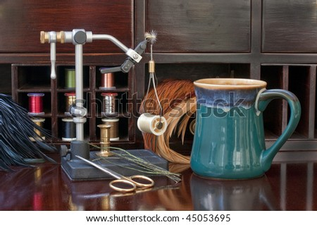 Fly Tying bench with equipment set up for a relaxing evening of tying trout flies. - stock photo