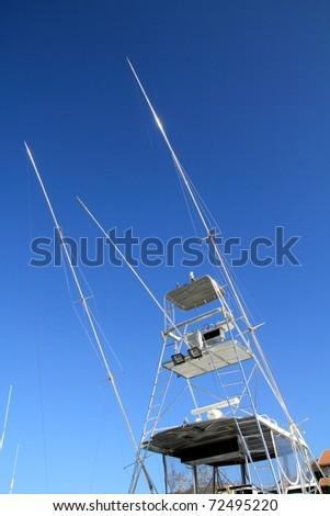 Flybridge fisher boat high fly bridge tuna tower on blue sky - stock photo
