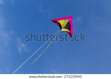 Flying a kite up high. - stock photo