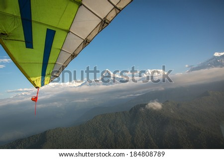 Flying a microlight along the Annapurna mountain range in the Himalayas, Nepal - stock photo
