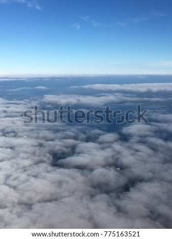 Flying above a sea of clouds