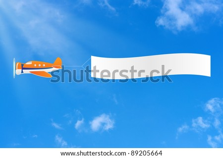 Flying aircraft carries banner in sky.