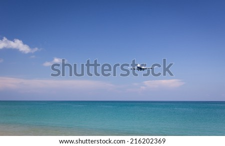 Flying aircraft coming to the beach Phuket airport Thailand - stock photo