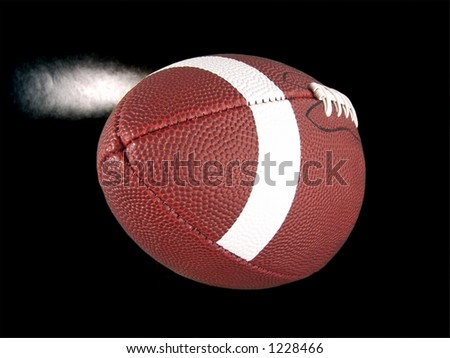 Flying American Football (With Steam) - stock photo